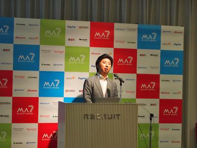 7回目の開催にあたり,挨拶を述べるMA7実行委員会委員長 羽野仁彦氏