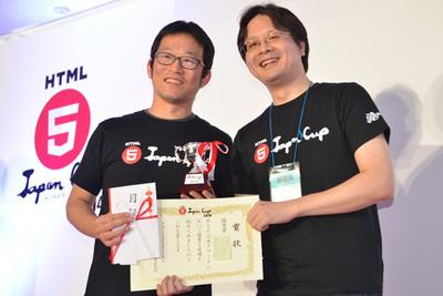 優秀賞のあんどう氏(左)とプレゼンターで審査委員長の古川氏
