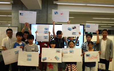 参加の小学生メンバー,豊嶋花さん(中央)と竹林氏(左端),松田校長(右端)