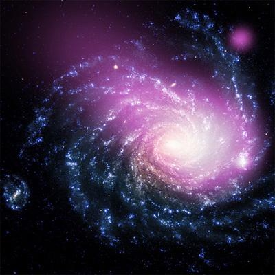 ハッブルとチャンドラの写真を合成したもの。中央から左上にかけて見られるX線放射が銀河の衝突で生じ,右端のX線の輝きが衝撃波で引き起こされた恒星の誕生部分。