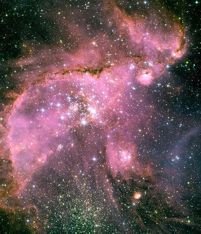 銀河系の重量にひきずられて形が崩れたと言われる小マゼラン銀河