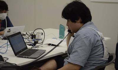 IP Phoneのパケットキャプチャをしつつ,運営委員と通話を試みる様子